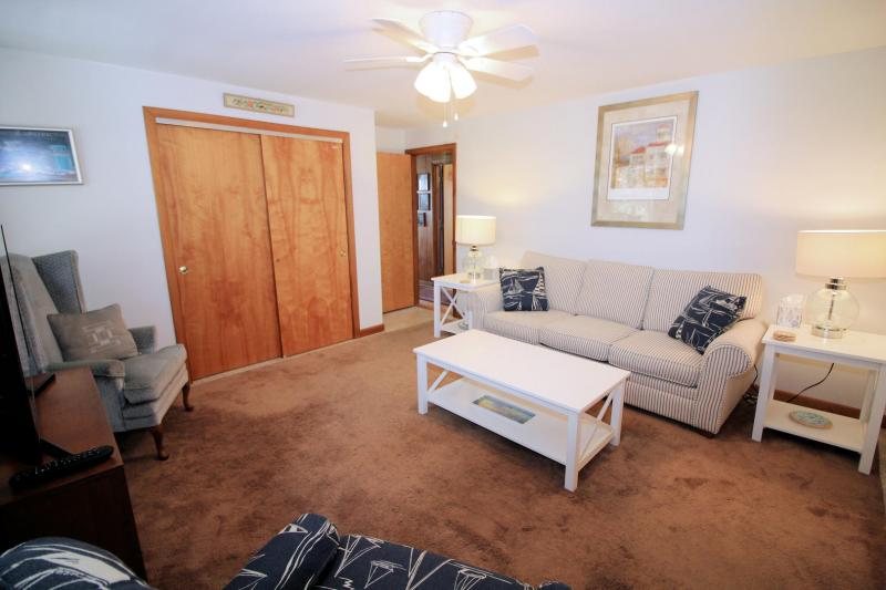 First floor den with comfortable seating and TV