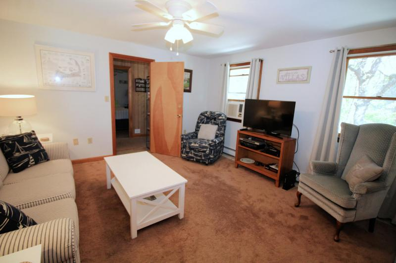 First floor family room with flat screen TV and cable