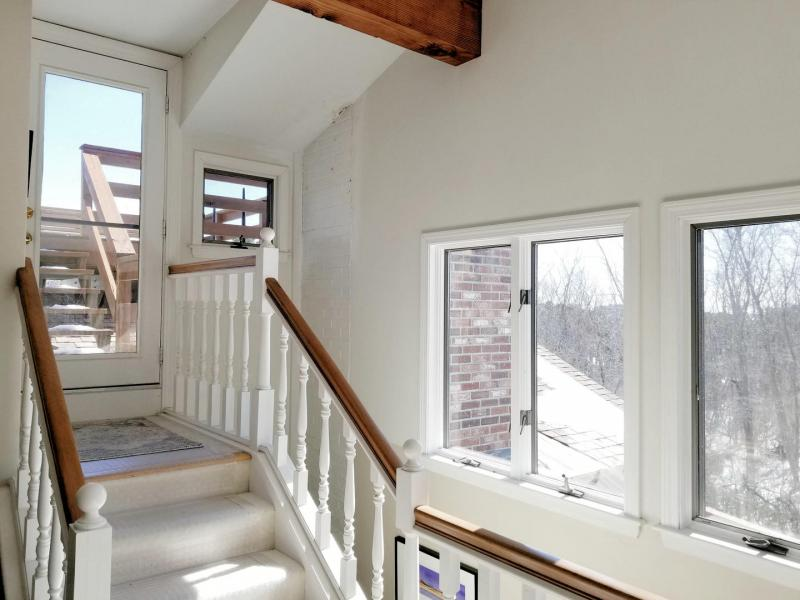 Stairs from sitting room lead to roof deck with bay views