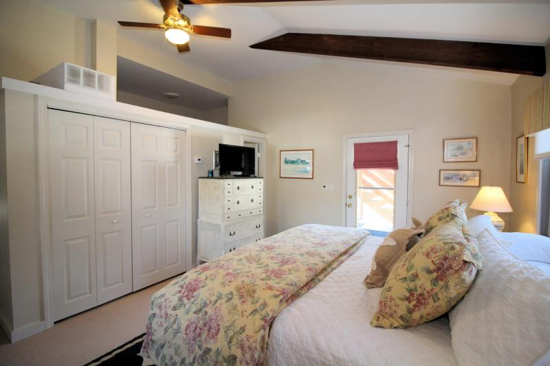 Entrance level bedroom with king and TV