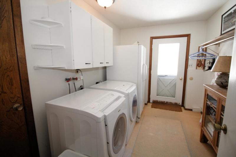 Lower level laundry room with washer and dryer