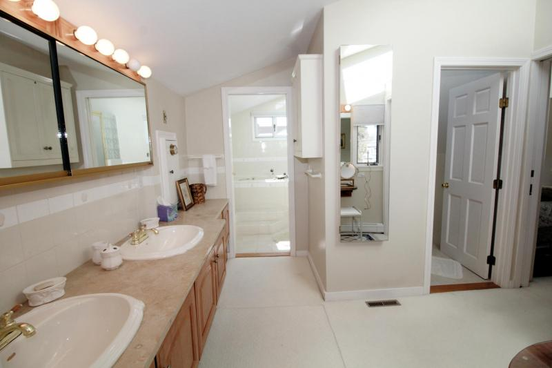 Second floor master en suite bathroom with double sink