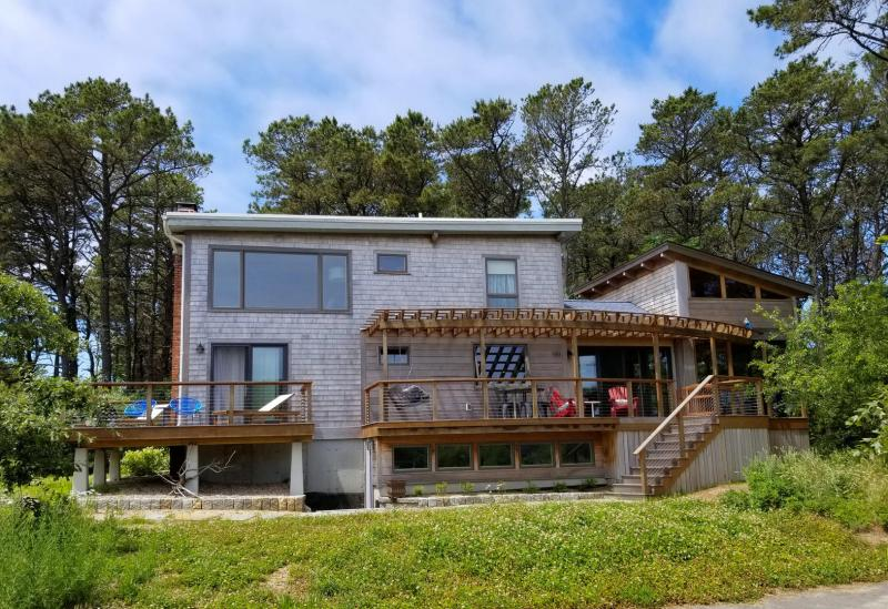 Spacious deck has a porch swing and beautiful views