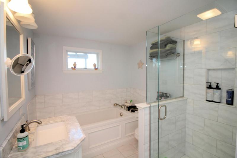 First floor bathroom with separate shower and soaking tub
