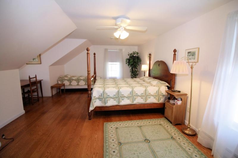 Second floor bedroom with queen bed and twin bed