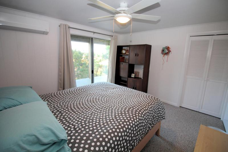 Other of two lower level bedrooms with queen bed