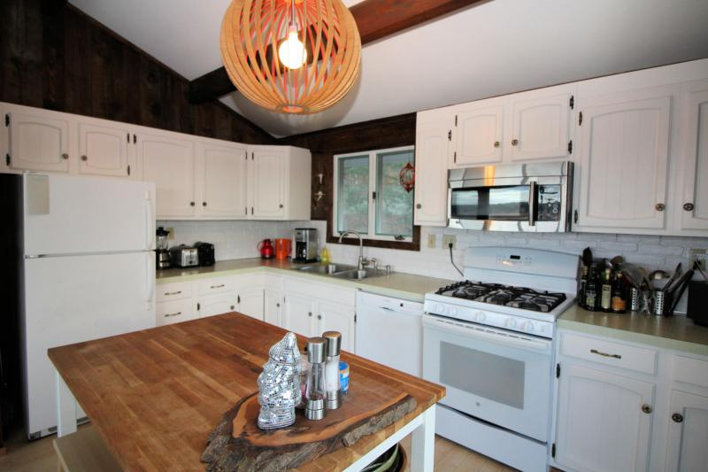 Kitchen has a dishwasher and other small appliances
